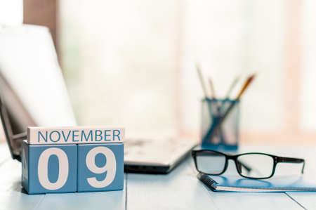 9th: November 9th. Day 9 of month, calendar on freelancer workplace background.