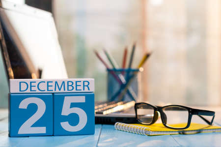december 25th: December 25th Eve Christmas. Day 25 of month, calendar on manager workplace background.