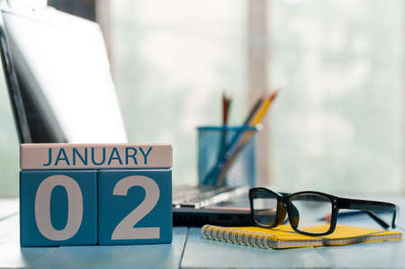 January 2nd. Day 2 of month, calendar on business office background.
