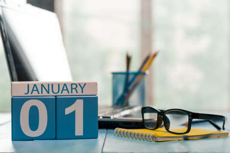 HI: January 1st. Day 1 of month, calendar on teacher workplace background.