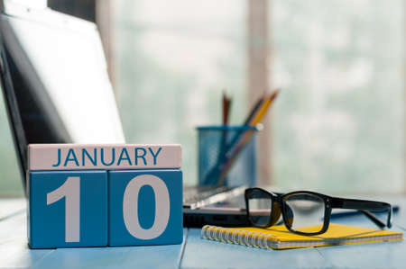 important date: January 10th. Day 10 of month, calendar on analyst workplace background.