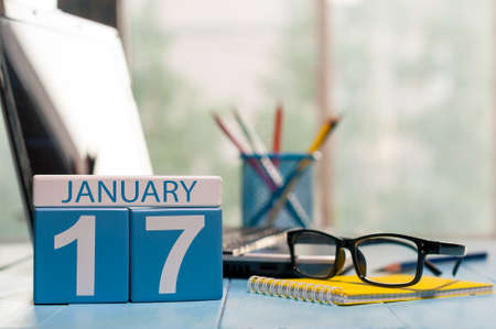 17th: January 17th. Day 17 of month, calendar on Customer Services Assistant workplace background. Stock Photo