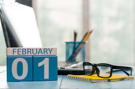 February 1st. Day 1 of month, calendar on teacher workplace background. Stock Photo