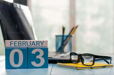 3 month: February 3rd. Day 3 of month, calendar on insurance agent workplace background.
