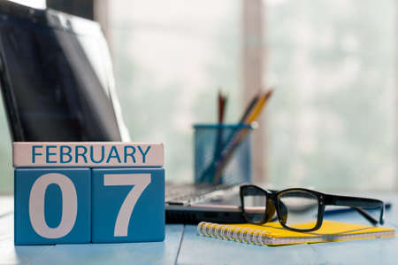 important date: February 7th. Day 7 of month, calendar on CEO workplace background.