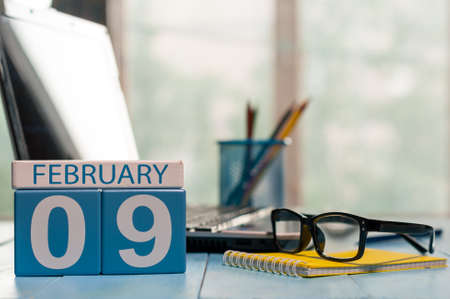 9th: February 9th. Day 9 of month, calendar on freelancer workplace background.