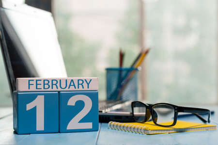 February 12th. Day 12 of month, calendar on Database Administrator workplace background.