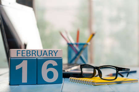 important date: February 16th. Day 16 of month, calendar on Network Systems Analyst workplace background. Stock Photo