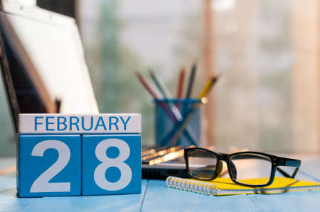 February 28th. Day 28 of month, calendar on blogger workplace background.