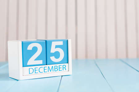 december 25th: December 25th Eve Christmas. Day 25 of month, calendar on wooden background.
