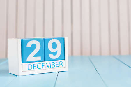 29: December 29th. Day 29 of month, calendar on wooden background.
