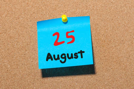 25th: August 25th. Day 25 of month, color sticker calendar on notice board. Summer time. Empty space for text. Stock Photo