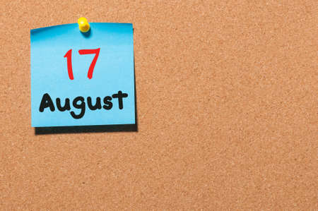 notice board: August 17th. Day 17 of month, color sticker calendar on notice board. Summer time. Empty space for text.