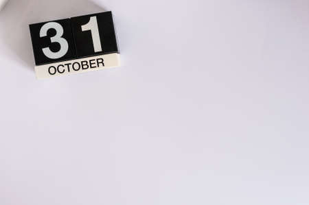 31st: October 31st. Day 31 of month, wooden color calendar on white background. Autumn time. Empty space for text.