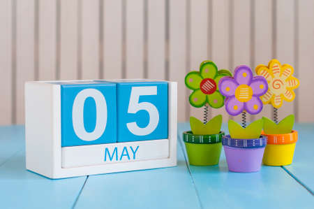 5th: May 5th. Image of may 5 wooden color calendar on white background with flowers. Spring day, empty space for text. International disabled rights  Day.