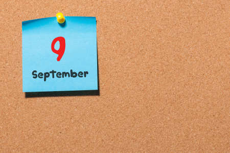 9th: September 9th. Day 9 of month, color sticker calendar on notice board. Autumn time. Empty space for text. Stock Photo