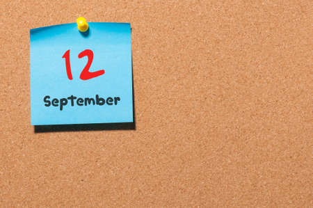 notice board: September 12th. Day 12 of month, color sticker calendar on notice board. Autumn time. Empty space for text.