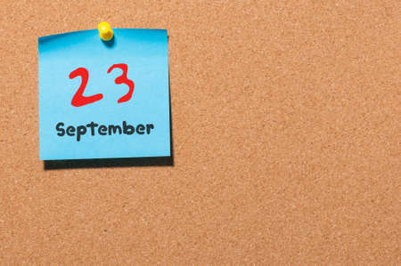20 23 years: September 23rd. Day 23 of month, color sticker calendar on notice board. Autumn time. Empty space for text.