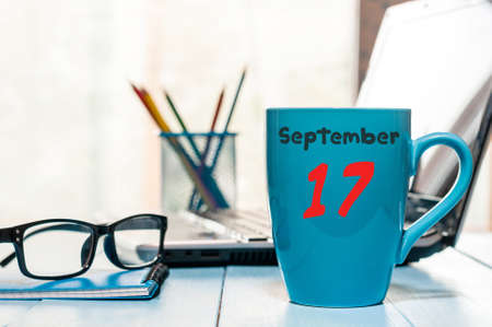 17th: September 17th. Day 17 of month, calendar on Network Systems Analyst workplace background. Autumn time. Empty space for text. Stock Photo