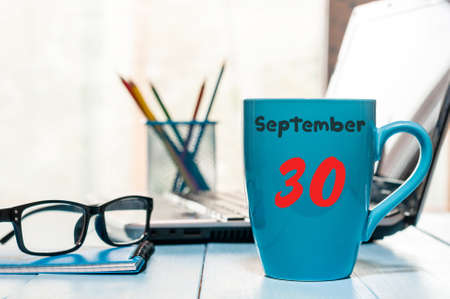 September 30th. Day 30 of month, calendar on translator or interpreter workplace background. Autumn time. Empty space for text.
