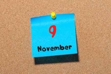 9th: November 9th. Day 9 of month, color sticker calendar on notice board. Autumn time. Empty space for text. Stock Photo