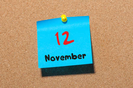 notice board: November 12th. Day 12 of month, color sticker calendar on notice board. Autumn time. Empty space for text. Stock Photo