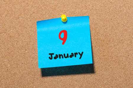 9th: January 9th. Day 9 of month, Calendar on cork notice board. Winter time. Empty space for text.