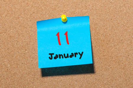 11th: January 11th. Day 11 of month, Calendar on cork notice board. Winter time. Empty space for text.