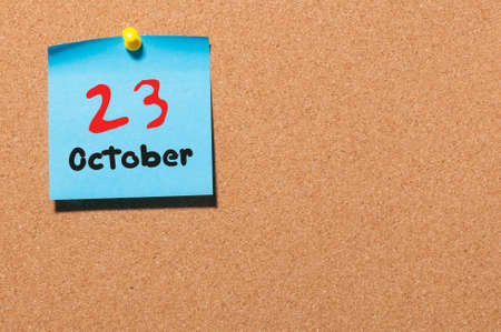 20 23 years: October 23rd. Day 23 of month, color sticker calendar on notice board. Autumn time. Empty space for text.