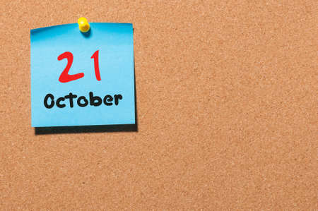 ceasefire: October 21st. Day 21 of month, color sticker calendar on notice board. Autumn time. Empty space for text. Stock Photo