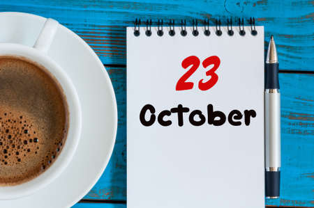 20 23 years: October 23rd. Day 23 of month, calendar with coffee cup Customer Services Assistant workplace background. Autumn time.