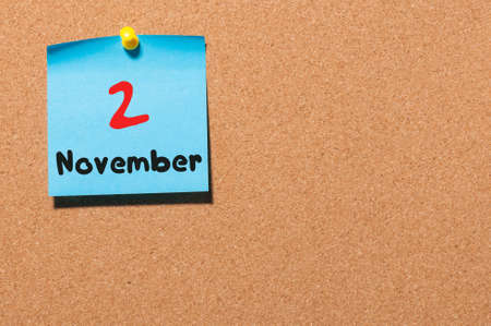 2 november: November 2nd. Day 2 of month. Calendar on notice board. Autumn time. Empty space for text.