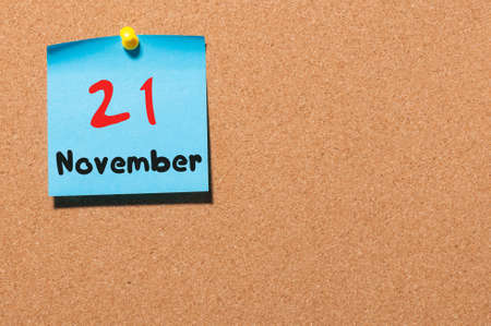 ceasefire: November 21st. Day 21 of month, color sticker calendar on notice board. Autumn time. Empty space for text.