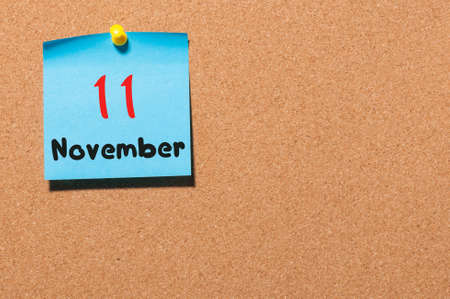 11th: November 11th. Day 11 of month, color sticker calendar on notice board. Autumn time. Empty space for text. Stock Photo