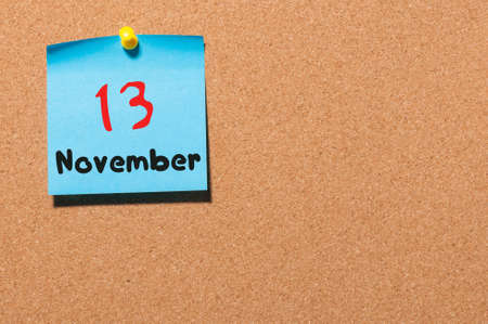 notice board: November 13th. Day 13 of month, color sticker calendar on notice board. Autumn time. Empty space for text.