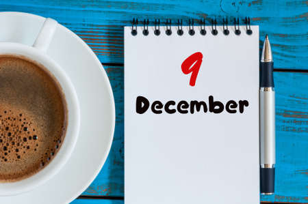 9th: December 9th. Day 9 of month, calendar on freelancer workplace background with coffee cup. Top view. Winter time. Empty space for text.