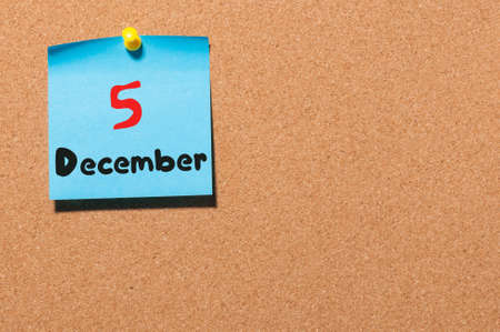 5th: December 5th. Day 5 of month, Calendar on cork notice board. Winter time. Empty space for text.