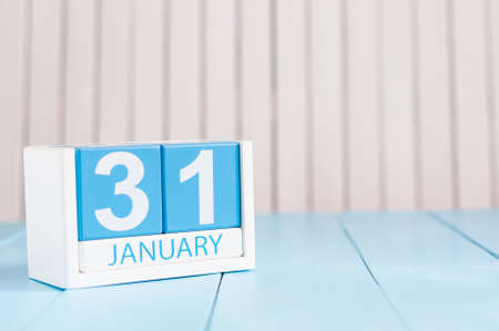 31st: January 31st. Day 31 of month, calendar on wooden background. Winter at work concept. Empty space for text.