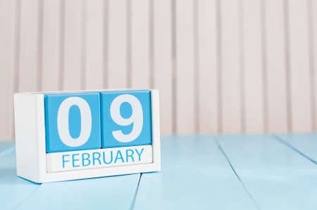 9th: February 9th. Day 9 of month, calendar on wooden background. Winter concept. Empty space for text.
