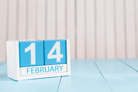 february 14th: February 14th. Day 14 of month, calendar on wooden background. Winter time. Empty space for text.