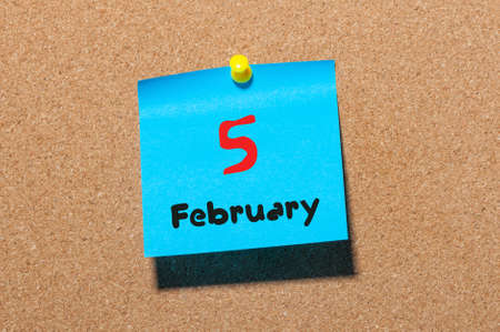 5th: February 5th. Day 5 of month, calendar on cork notice board background. Winter time. Empty space for text.