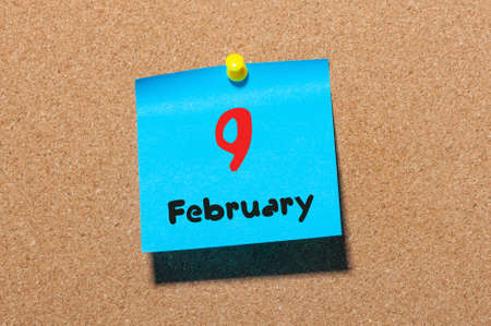 9th: February 9th. Day 9 of month, calendar on cork notice board background. Winter concept. Empty space for text.