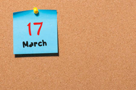 17th: March 17th. Day 17 of month, calendar on cork notice board background. Spring time, empty space for text. Stock Photo