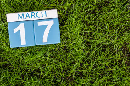 march 17th: Happy St Patricks Days save the date. March 17th. Day 17 of month, calendar on football green grass background. Spring time, empty space for text.