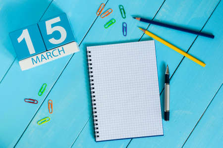 consumer rights: March 15th. Day 5 of month, calendar on blue wooden table background with notepad. Spring time, empty space for text. World Consumer Rights Days.