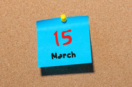 15th: March 15th. Day 15 of month, calendar on cork notice board background. Spring time, empty space for text. Stock Photo