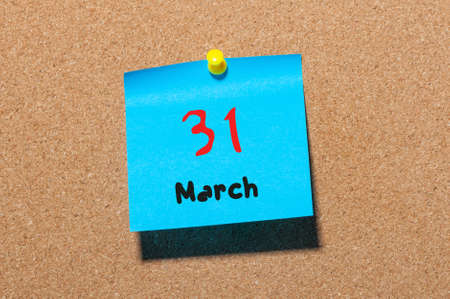 31st: March 31st. Day 31 of month, calendar on cork notice board background. Spring time, empty space for text.