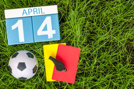 personal organiser: April 14th. Day 14 of month, calendar on football green grass background. Spring time.