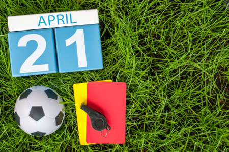 important date: April 21st. Day 21 of month, calendar on football green grass background. Spring time, empty space for text.
