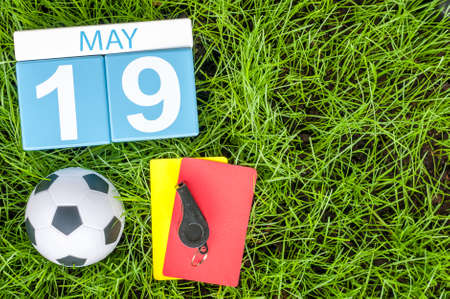 19: May 19th. Day 19 of month, calendar with football green grass background. Spring time.